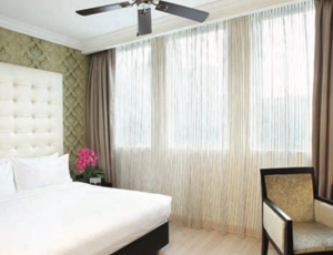 1 Night Stay at Village Hotel Albert Court's Deluxe Room with Buffet Breakfast for 2 Persons and 1-Hour Choice of Full Body Massage for 2 People at Facebar N Skin Tanjong Pagar